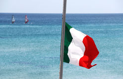 Flag of italy. A close up view of a flag of italy, against the sea, landscape cut Royalty Free Stock Images