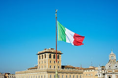 Flag of Italy over city of Rome Stock Photography