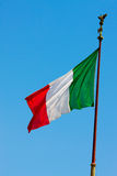 Flag of Italy over sky Royalty Free Stock Image