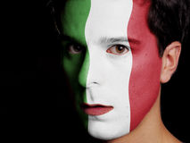 Flag of Italy. Painted on a Face of a Young Man Stock Photo