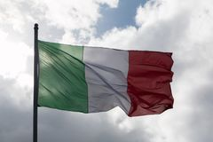 The flag of Italy. In the photo you see the flag of Italy against the sky Stock Photo