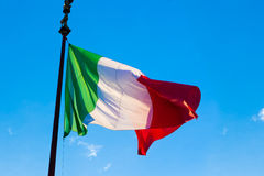 Flag of Italy, waving in the wind, on the sky Royalty Free Stock Photography