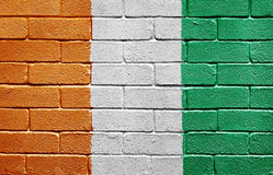 Flag of Ivory Coast on brick wall Stock Photography