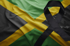 Flag of jamaica with black mourning ribbon Royalty Free Stock Photography