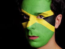 Flag of Jamaica. Painted on a Face of a Young Man stock image