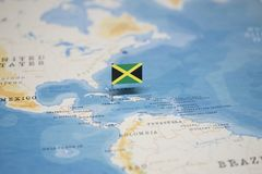 The Flag of jamaica in the world map.  stock photos