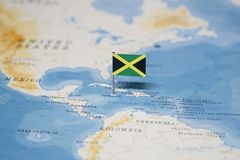 The Flag of jamaica in the world map.  royalty free stock image