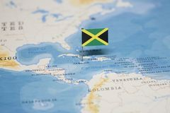 The Flag of jamaica in the world map.  royalty free stock images