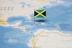 The Flag of jamaica in the world map.  stock image
