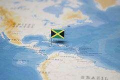 The Flag of jamaica in the world map.  stock images