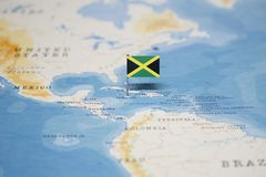 The Flag of jamaica in the world map royalty free stock photo