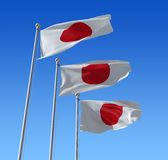 Flag of Japan against blue sky. Stock Photo