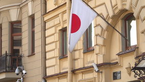 The flag of Japan on the building of the General Consulate of Japan in St. Petersburg stock footage
