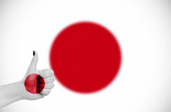 Flag of Japan on hand Stock Photo