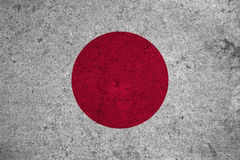 Flag. Japan flag on an old grunge background Royalty Free Stock Images