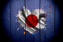 Flag of Japan in the shape of heart on a dark background stock photography