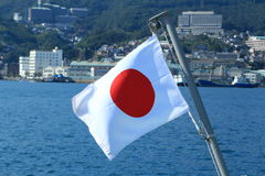 Flag of Japan on the ship. Flag of Japan, over the sea Royalty Free Stock Image