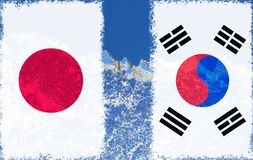 The flag of Japan and South Korea are painted at opposite end of piece of ice in the form of an arctic iceberg against blue sky. Cold war, warming background royalty free stock photos