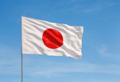 Flag of Japan. Waving flag of Japan on a sky background stock photo