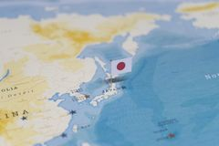 The flag of japan in the world map royalty free stock images