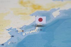 The flag of japan in the world map royalty free stock photo