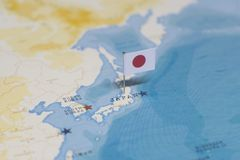 The flag of japan in the world map stock images