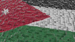 Flag of Jordan being made with jigsaw puzzle pieces. Jordanian problem solution conceptual 3D rendering. Flag made of puzzle pieces, conceptual 3D royalty free illustration