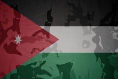 Flag of jordan on the khaki texture . military concept. Flag of jordan on the khaki texture background. military concept Royalty Free Stock Image