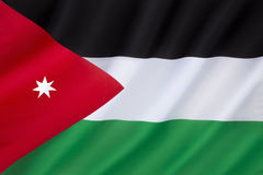 Flag of Jordan. Officially adopted on 18th April 1928. Based on the flag of the Arab Revolt against the Ottoman Empire during World War I. The seven-pointed Stock Photos