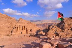 Flag in Jordan in Petra with palace under a blue sky royalty free stock photos