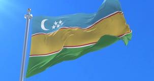 Karakalpakstan flag waving at wind with blue sky in slow, loop. Flag of Karakalpakstan waving at wind with blue sky in slow, looped stock footage
