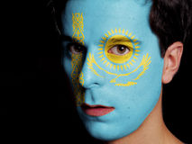 Flag of Kazakhstan. Painted on a Face of a Young Man Stock Photos
