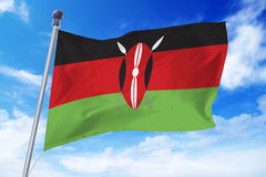 Flag of Kenya developing against a blue sky stock photography