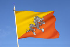 Flag of the Kingdom of Bhutan. The national flag of The Kingdom of Bhutan - The flag is based upon the tradition of the Drukpa Lineage of Tibetan Buddhism and Stock Photo