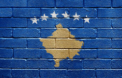 Flag of Kosovo on brick wall Stock Images