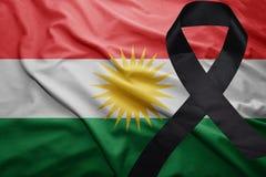 Flag of kurdistan with black mourning ribbon. Waving national flag of kurdistan with black mourning ribbon Stock Photography