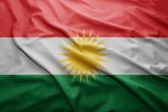 Flag of Kurdistan. Waving colorful national Kurdistan flag Stock Images