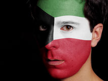 Flag of Kuwait. Painted on a Face of a Young Man stock images