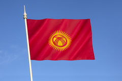 Flag of Kyrgyzstan. Adopted on 3rd March 1992 by the Supreme Council of Kyrgyzstan. Red symbolizes bravery, the sun represents peace and wealth, and the Royalty Free Stock Photography