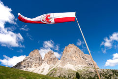 Flag Ladin abreast of Sella in Val Gardena with the Sella Group Stock Photo