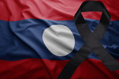 Flag of laos with black mourning ribbon. Waving national flag of laos with black mourning ribbon Royalty Free Stock Images