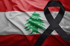 Flag of lebanon with black mourning ribbon. Waving national flag of lebanon with black mourning ribbon Royalty Free Stock Photos