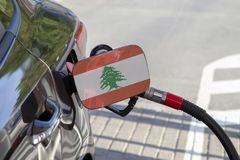 Flag of Lebanon on the car`s fuel filler flap. stock image