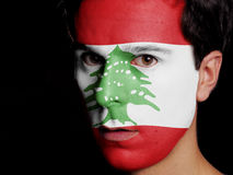 Flag of Lebanon. Painted on a Face of a Young Man stock photo
