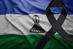 Flag of lesotho with black mourning ribbon Royalty Free Stock Images