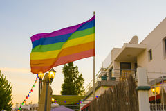 Flag lgbt against the backdrop of the sunet in an open-air bar. Flag lgbt against the backdrop of the setting sun in an open-air bar royalty free stock photos