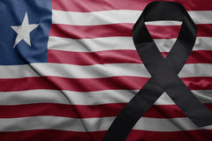 Flag of liberia with black mourning ribbon Stock Photos