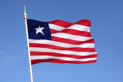 Flag of Liberia - Flag of Convenience. The Liberian flag was adopted on July 26, 1847.The flag is seen on many ships around the world as Liberia offers royalty free stock photos