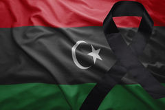Flag of libya with black mourning ribbon Stock Images