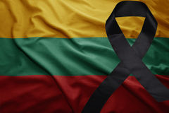 Flag of lithuania with black mourning ribbon. Waving national flag of lithuania with black mourning ribbon Stock Photos